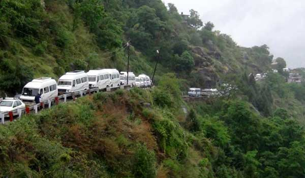 Devotees stranded in Chamoli district of Uttarakhand after Badrinath Yatra got suspended, on May 15, 2014.
