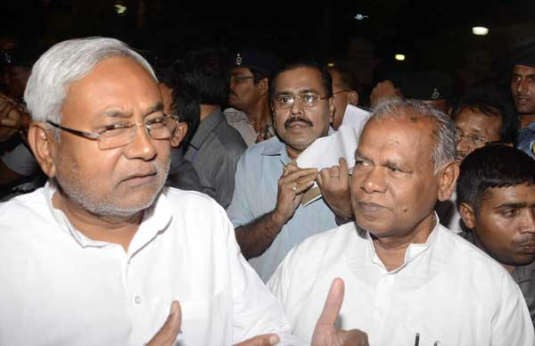 Newly elected Bihar Chief Minister Jitan Ram Majhi with JD-U leader Nitish Kumar as they come out of Raj Bhawan in Patna on May 19, 2014.