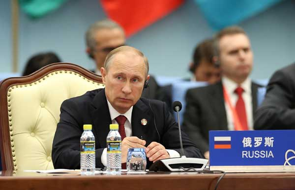 Russian President Vladimir Putin attends the fourth summit of the Conference on Interaction and Confidence Building Measures in Asia (CICA) in Shanghai, east China, May 21, 2014.
