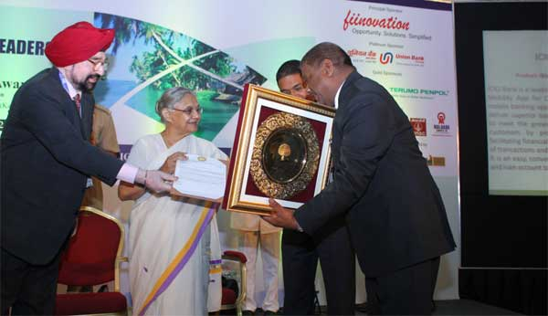 S.K. Mohanty, General Manager, PNB receiving the Golden Peacock Award for the year 2014 (24th World Congress on Total Quality) from her Excellency Sheila Dikshit, Hon'ble Governor of Kerala in the function organised at Trivendrum.   Lt.Gen J.S. Ahluwalia, PVSM (Retd), President, Institute of Directors India and S.Chakraborty, Chief Executive, Innovative Financial Advisors are also seen in the picture.