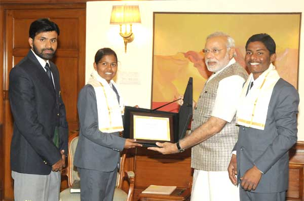 Poorna Malavath and Anand Kumar, teenaged mountaineers who recently scaled Mt. Everest, calling on the Prime Minister, Narendra Modi, in New Delhi. Their coach, Shekhar Babu is also seen