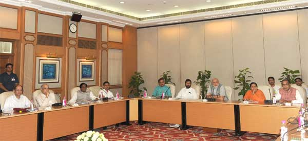 The Prime Minister, Narendra Modi chairing a meeting on monsoon, farming and rural economy, in New Delhi on June 13, 2014. The Union Minister for Water Resources, River Development and Ganga Rejuvenation, Sushri Uma Bharati, the Union Minister for Consumer Affairs, Food and Public Distribution, Ramvilas Paswan, the Union Minister for Chemicals and Fertilizers, Ananthkumar, the Union Minister for Agriculture, Radha Mohan Singh and other dignitaries are also seen.