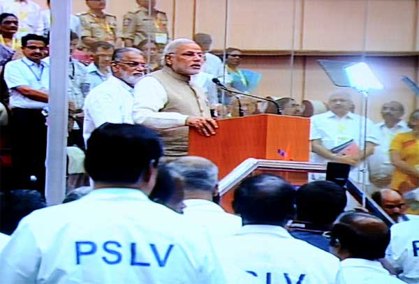 The Prime Minister, Narendra Modi addressing after the successful launch of PSLV - C 23, at Sriharikota, in Andhra Pradesh on June 30, 2014. The ISRO Chairman, Dr. K Radhakrishnan is also seen.