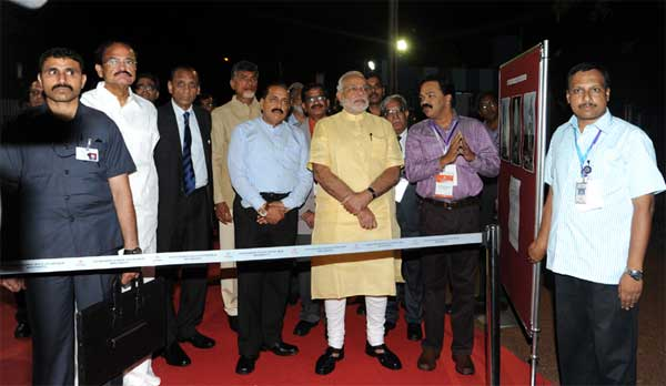 The Prime Minister, Narendra Modi being briefed by the senior scientists, during his visit GSLV Mk III Vehicle Assembly Building, at Sriharikota, in Andhra Pradesh on June 29, 2014. The Minister of State for Science and Technology (Independent Charge), Earth Sciences (Independent Charge), Prime Minister Office, Personnel, Public Grievances & Pensions, Department of Atomic Energy and Department of Space, Dr. Jitendra Singh is also seen.