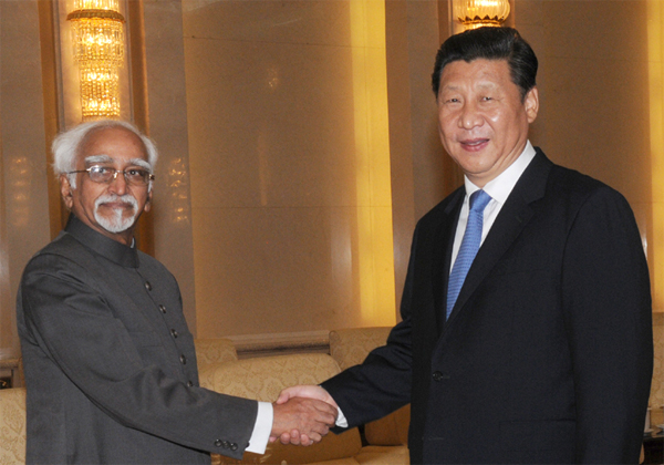 The Vice President, Mohd. Hamid Ansari meeting the President of the People's Republic of China, Xi Jinping, in Beijing, China on June 30, 2014.