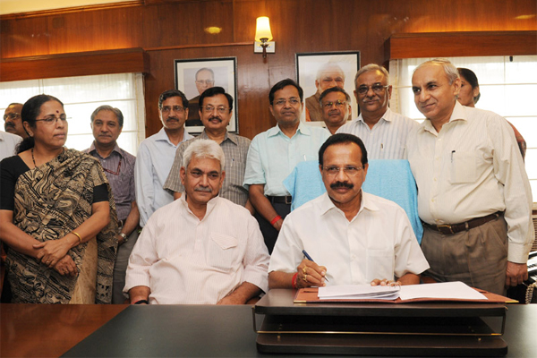 The Union Minister for Railways, D.V. Sadananda Gowda giving finishing touches to the Railway Budget 2014-15, in New Delhi on July 07, 2014. The Minister of State for Railways, Manoj Sinha, the Chairman, Railway Board, Arunendra Kumar and other Board Members are also seen.
