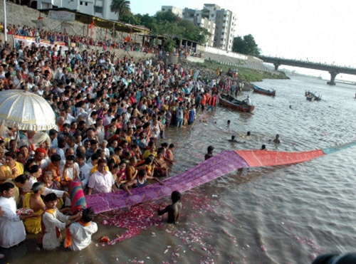 """People celebrate birthday of river """"Tapi"""" who is daughter of """"Sun"""" by performing """"Maha Arti"""" on bank of Tapi in Surat."""