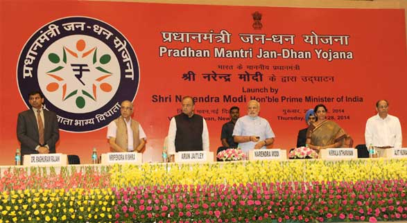 The Prime Minister, Narendra Modi launching the 'Pradhan Mantri Jan Dhan Yojana (PMJDY)', in New Delhi on August 28, 2014. The Union Minister for Finance, Corporate Affairs and Defence, Arun Jaitley, the Minister of State for Commerce & Industry (Independent Charge), Finance and Corporate Affairs, Nirmala Sitharaman, the Principal Secretary to Prime Minister, Nripendra Misra, the Governor of Reserve Bank of India, Raghuram Rajan and other dignitaries are also seen.