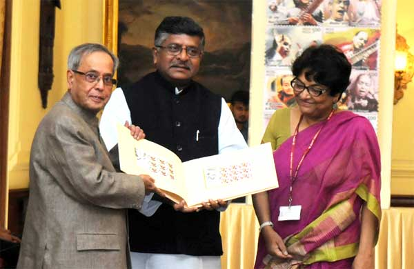 "The President, Pranab Mukherjee releasing a ""Set of Eight Commemorative Postage Stamps of Indian Musicians"" at Rashtrapati Bhawan, in New Delhi on September 03, 2014. The Union Minister for Communications & Information Technology and Law & Justice, Ravi Shankar Prasad and the Secretary (Posts) & Chairman, PS Board, Kavery Banerjee are also seen."
