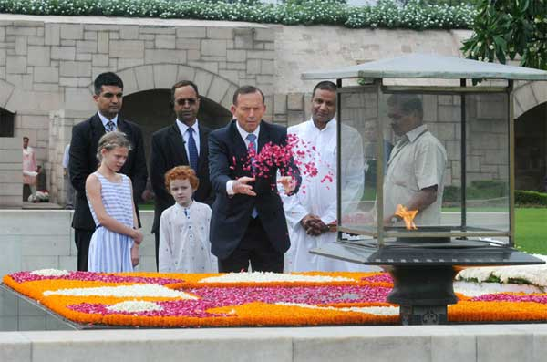 The Prime Minister of Australia, Tony Abbott paying floral tributes, at the Samadhi of Mahatma Gandhi, at Rajghat, in Delhi on September 05, 2014.