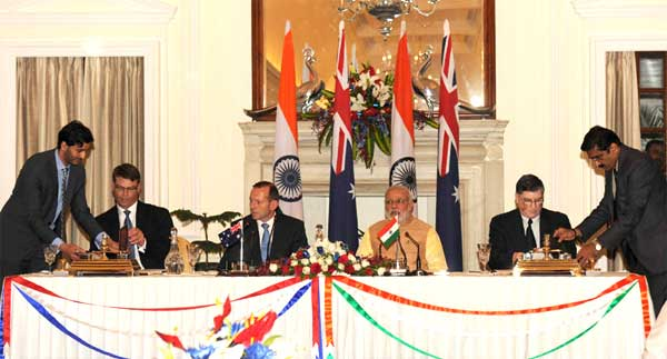 The MD & CEO, NSDC, Shri Dilip Chenoy and the High Commissioner of Australia to India, Patrick Suckling signing an MoU on cooperation in Technical Vocational Education and Training (TVET) , in the presence of the Prime Minister, Narendra Modi and the Prime Minister of Australia, Tony Abbott, in New Delhi on September 05, 2014.