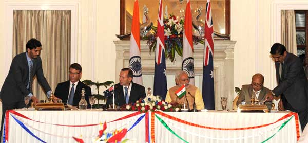 The Secretary, Department of Sports, Ministry of Skill Development, Entrepreneurship, Youth Affairs and Sports, Ajit Mohan Sharan and the High Commissioner of Australia to India, Patrick Suckling signing an MoU on cooperation in Sport, in the presence of the Prime Minister, Narendra Modi and the Prime Minister of Australia, Tony Abbott, in New Delhi on September 05, 2014.