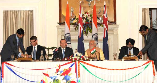 The Additional Secretary, Ministry of Water Resources Dr. Amarjit Singh and the High Commissioner of Australia to India, Patrick Suckling signing the renewal of MoU on cooperation in the field of Water Resources Management, in the presence of the Prime Minister, Narendra Modi and the Prime Minister of Australia, Tony Abbott, in New Delhi on September 05, 2014.