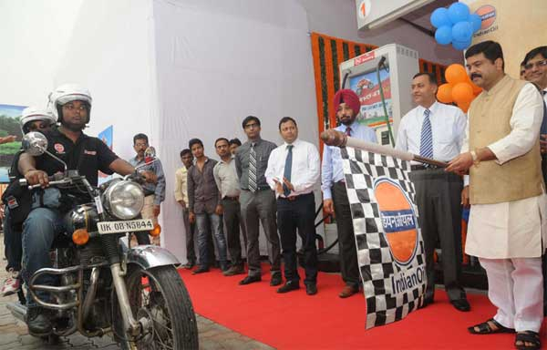 The Minister of State (Independent Charge) for Petroleum and Natural Gas, Dharmendra Pradhan flagging off a motorcycle expedition to Ladakh, in New Delhi on September 11, 2014.