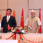 The Prime Minister, Narendra Modi and the Chinese President, Xi Jinping witnessing the signing of an MoU for establishing 'Sister Province' relations between Guangdong, China and Gujarat, India which covers cooperation in economy and trade, environmental protection, public policy education, health, science and technology, tourism and culture, at Hyatt Hotel, Ahmedabad on September 17, 2014.