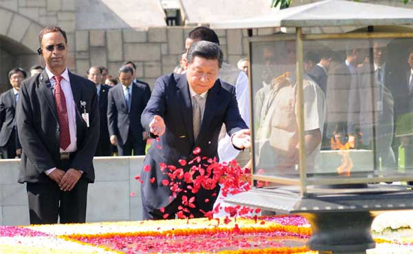 The Chinese President, Xi Jinping paying floral tributes at the Samadhi of Mahatma Gandhi, at Rajghat, in Delhi on September 18, 2014.