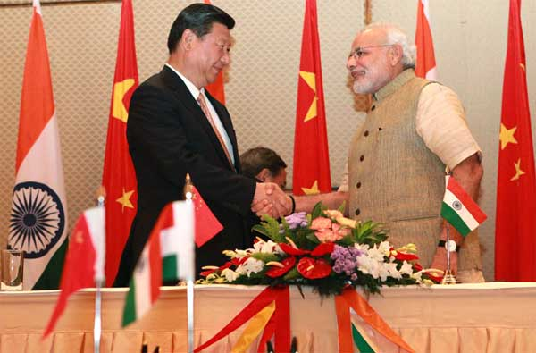 The Prime Minister, Narendra Modi shaking hands with the Chinese President, Xi Jinping, after signing of agreements, at Hyatt Hotel, Ahmedabad on September 17, 2014.
