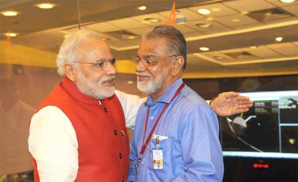 The Prime Minister, Narendra Modi congratulating the ISRO Chairman, Dr. K Radhakrishnan after successful Insertion of Mars Orbiter (Mangalyan) into the Mars orbit, at ISRO Headquarters, in Bengaluru on September 24, 2014.