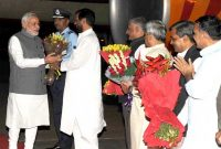 The Prime Minister, Narendra Modi being welcomed on his arrival by the Minister for Consumer Affairs, Food and Public Distribution, Ram Vilas Paswan, at Palam Airport, in New Delhi on October 01, 2014.