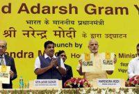 "The Prime Minister, Narendra Modi releasing the brochure at the launch of the ""Saansad Adarsh Gram Yojana"", in New Delhi"