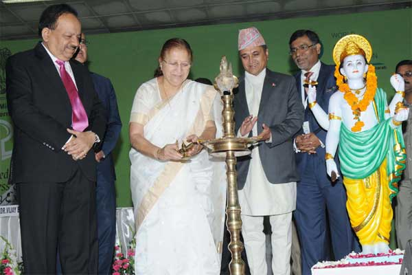 The Speaker, Lok Sabha, Sumitra Mahajan lighting the lamp to inaugurate the 6th World Ayurveda Congress, at Pragati Maidan, in New Delhi on November 07, 2014. The Union Minister for Health and Family Welfare, Dr. Harsh Vardhan is also seen.