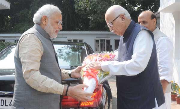 The Prime Minister, Narendra Modi greeting Lal Krishana Advani on his birthday, in New Delhi on November 08, 2014. The Union Home Minister, Rajnath Singh is also seen.