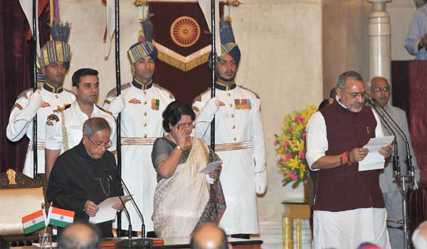 The President, Pranab Mukherjee administering the oath as Minister of State to Giriraj Singh, at a Swearing-in Ceremony, at Rashtrapati Bhavan, in New Delhi on November 09, 2014.