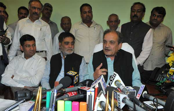 Chaudhary Birender Singh addressing the media after taking charge as the Union Minister for Rural Development, Panchayati Raj, Drinking Water and Sanitation, in New Delhi on November 11, 2014. The Minister of State for Drinking Water & Sanitation, Ram Kripal Yadav and the Minister of State for Panchayati Raj, Nihalchand are also seen.
