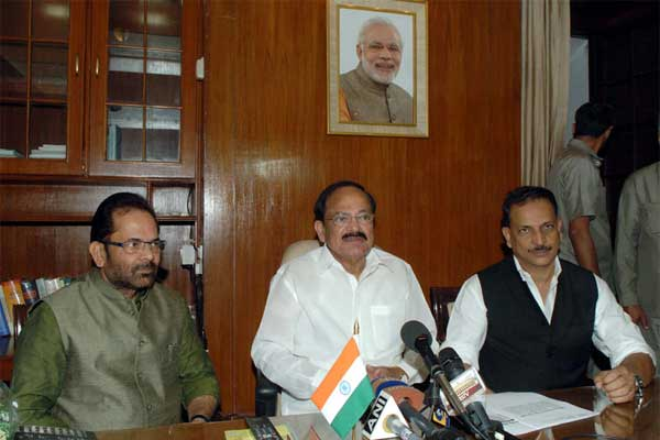 Rajiv Pratap Rudy and Mukhtar Abbas Naqvi taking charge as the Ministers of State for Parliamentary Affairs in the presence of the Union Minister for Urban Development, Housing and Urban Poverty Alleviation and Parliamentary Affairs, M. Venkaiah Naidu, in New Delhi on November 11, 2014.