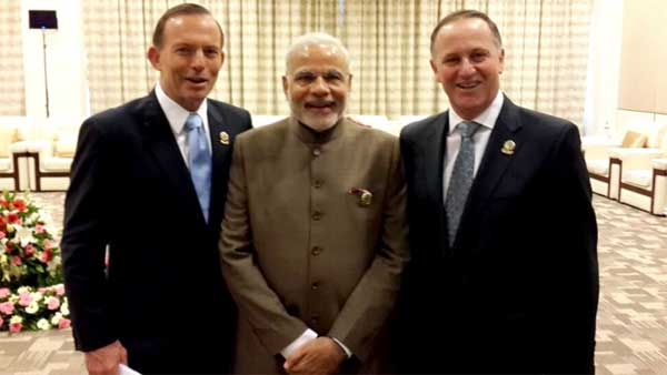 Neighbors across the ocean the Prime Minister, Narendra Modi with the Prime Minister of New Zealand, John Key and the Prime Minister of Australia, Tony Abbott, at the East Asia Summit, in Nay Pyi Taw, Myanmar on November 13, 2014.