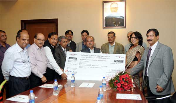 The Union Minister for Mines and Steel, Narendra Singh Tomar receiving the dividend cheque from the CMD of MECON, A.K. Tyagi, in New Delhi on November 13, 2014. The Secretary, Ministry of Steel, Rakesh Singh is also seen.