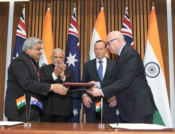 The Prime Minister, Narendra Modi and the Prime Minister of Australia, Tony Abbott witnessing the signing of agreements, at Parliament House, in Canberra, Australia on November 18, 2014.