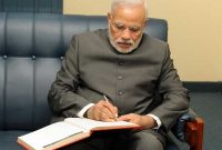 The Prime Minister, Narendra Modi signing the visitors' book at the PMO, in Suva, Fiji on November 19, 2014.