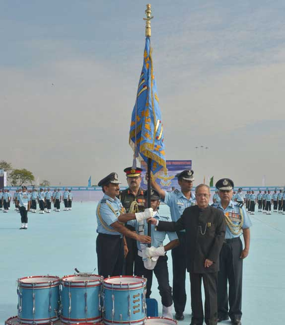 The President of India, Pranab Mukherjee awarding Standards to 115 Helicopter Unit and 26 Squadron of Indian Air Force, at Tezpur, in Assam on November 21, 2014. The Chief of the Air Staff, Air Chief Marshal Arup Raha is also seen.