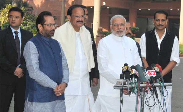 The Prime Minister, Narendra Modi interacting with the media on his arrival at Parliament House for the Winter Session of the Parliament, in New Delhi on November 24, 2014. The Union Minister for Urban Development, Housing and Urban Poverty Alleviation and Parliamentary Affairs, M. Venkaiah Naidu, the Minister of State for Development of North Eastern Region (I/C), Prime Minister's Office, Personnel, Public Grievances & Pensions, Department of Atomic Energy, Department of Space, Dr. Jitendra Singh, the Minister of State for Skill Development & Entrepreneurship (Independent Charge) and Parliamentary Affairs, Rajiv Pratap Rudy and the Minister of State for Minority Affairs and Parliamentary Affairs, Mukhtar Abbas Naqvi are also seen.
