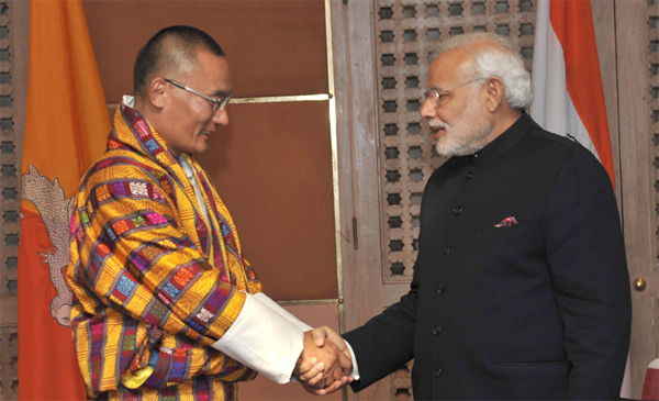 The Prime Minister, Narendra Modi being greeted by the Prime Minister of Bhutan, Tshering Tobgay, at the 18th SAARC Summit, in Kathmandu, Nepal on November 26, 2014.