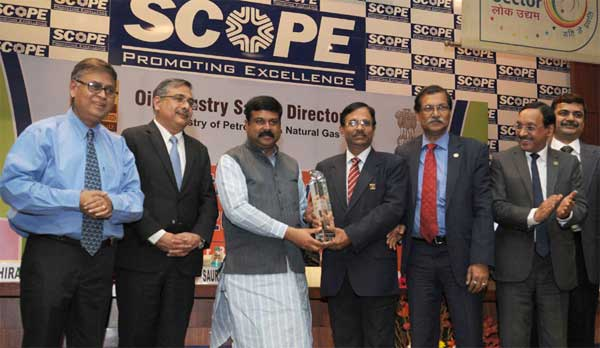 The Minister of State (Independent Charge) for Petroleum and Natural Gas, Dharmendra Pradhan presenting the Oil Industry Safety Awards, in New Delhi on December 03, 2014. The Secretary, Ministry of Petroleum & Natural Gas, Saurabh Chandra is also seen.