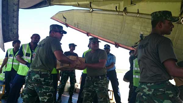 Packets of potable water being offloaded from the Indian Air Force fixed wing aircraft IL-76, in Maldives on December 07, 2014.