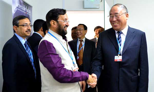 The Minister of State for Environment, Forest and Climate Change (Independent Charge), Prakash Javadekar meeting the Vice Chairman, NDRC, China, Xie Zhenhua, at UN Climate Change Conference, in Lima, Peru on December 08, 2014.