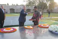 The President of the Chamber of Deputies of the Parliament, Romania, Valeriu Stefan Zgonea paying floral tributes at the Samadhi of Mahatma
