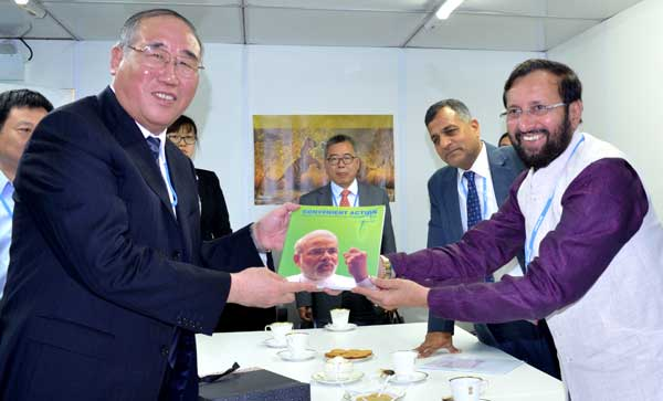 The Minister of State for Environment, Forest and Climate Change (Independent Charge), Prakash Javadekar presenting the book on Climate Change authored by the Prime Minister, Narendra Modi, to the Vice Chairman, NDRC, China, Xie Zhenhua, at UN Climate Change Conference, in Lima, Peru on December 08, 2014.
