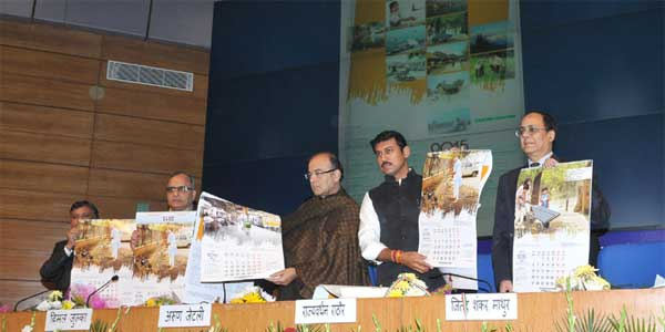 The Union Minister for Finance, Corporate Affairs and Information & Broadcasting, Arun Jaitley, the Minister of State for Information & Broadcasting, Col. Rajyavardhan Singh Rathore and the Secretary, Ministry of Information and Broadcasting, Bimal Julka releasing the Government of India Calendar 2015, in New Delhi on December 17, 2014.