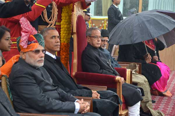 The President, Pranab Mukherjee, the Vice President, Mohd. Hamid Ansari, the Prime Minister, Narendra Modi and the Chief Guest US President, Barack Obama witnessing the 66th Republic Day Parade 2015, in New Delhi on January 26, 2015.