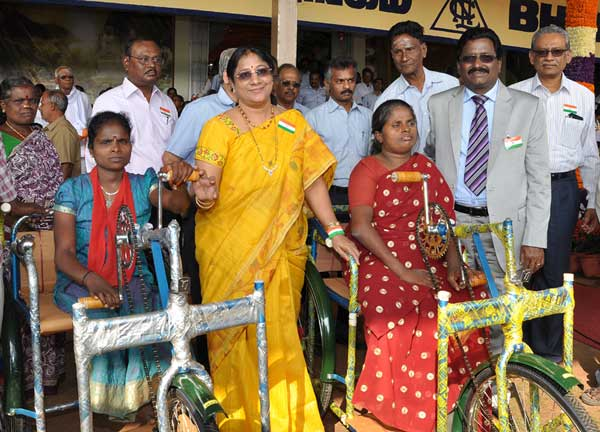 B. Surender Mohan, CMD, NLC and Smt. Surender mohan Presenting  Tricycles to Mahalakshmi and Iyammal, the Physically Challenged Women from Neyveli.