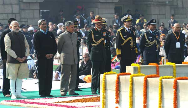 The Prime Minister, Narendra Modi paying homage at the Samadhi of Mahatma Gandhi on the occasion of Martyr's Day, at Rajghat, in Delhi on January 30, 2015. The Union Minister for Defence, Shri Manohar Parrikar, the Minister of State for Planning (Independent Charge) and Defence, Rao Inderjit Singh, the Defence Secretary, R.K. Mathur, three Service Chiefs: General Dalbir Singh, Admiral R.K. Dhowan and Air Chief Marshal Arup Raha are also seen.