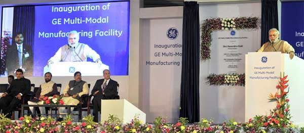The Prime Minister, Narendra Modi addressing at the inauguration of the Multimodal Manufacturing Project of GE, at Chakan, in Pune on February 14, 2015. The Chief Minister of Maharashtra, Devendra Fadnavis, the Minister of State for Environment, Forest and Climate Change (Independent Charge), Prakash Javadekar and other dignitaries are also seen.