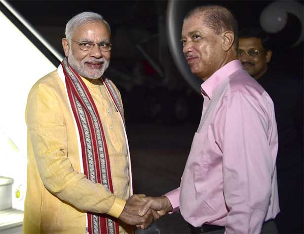 The Prime Minister, Narendra Modi being received by the President of Seychelles, James Michel on his arrival, at Seychelles International Airport on March 10, 2015.