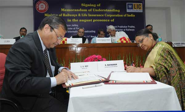 The Union Minister for Railways, Suresh Prabhakar Prabhu and the Union Minister for Finance, Corporate Affairs and Information & Broadcasting, Arun Jaitley witnessing the signing of a memorandum of understanding (MoU) between Ministry of Railways and Life Insurance Corporation of India, in New Delhi on March 11, 2015. The Minister of State for Railways, Manoj Sinha is also seen.