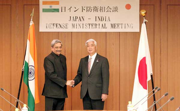 The Union Minister for Defence, Manohar Parrikar shaking hands with his Japanese counterpart General Nakatani during a Defence Ministerial Meeting, at Tokyo, in Japan on March 30, 2015.