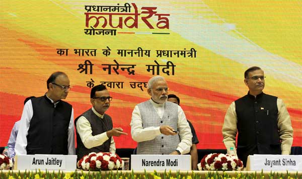 The Prime Minister, Narendra Modi launching the Pradhan Mantri MUDRA (Micro Units Development and Refinance Agency) Yojana, in New Delhi on April 08, 2015. The Union Minister for Finance, Corporate Affairs and Information & Broadcasting, Arun Jaitley, the Minister of State for Finance, Jayant Sinha and the Secretary, Department of Financial Services (DFS), Ministry of Finance, Dr. Hasmukh Adhia are also seen.